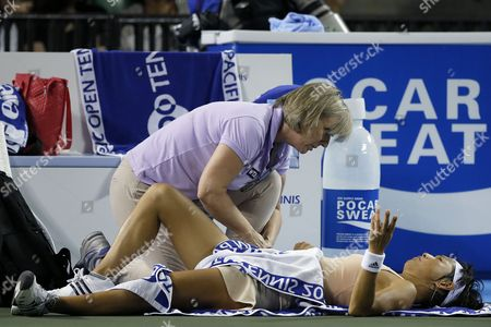 Kimiko Date-krumm of Japan Receives Medical Treatment As She Plays Against Victoria Azarenka of Belarus During Their First Round Match of the Toray Pan Pacific Open Tennis Tournament in Tokyo Japan 16 September 2014 Japan Tokyo
