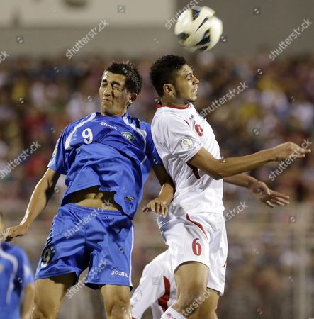 Jordanian Soccer Player Saeed Murjan (r) Fights For the Ball with Uzbekistan Soccer Player Odil Ahmedov (l) During World Cup 2014 Qualifying Playoff Soccer Match Between Jordan and Uzbekistan at King Abdullah Stadium in Amman Jordan on 06 September 2013 the Match Ended 1-1 Jordan Amman