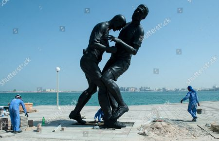 Epa03895867 Workers Install a Five-meter-tall Bronze Statue of Former French Soccer International Zinedine Zidane's Famous Head-butt at the Corniche of Doha Qatar 04 October 2013 the Sculpture 'Coup De Teête' ('head Butt') was Created by Algerian Artist Adel Abdessemed and Captures the Moment when France's Playmaker Zinedine Zidane Head-butted Italian Defender Marco Materazzi in the 2006 World Cup Final Epa/str Qatar Doha