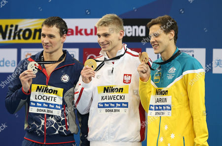 (l-r) Second Placed Tyler Clary of the Usa Winner Radoslaw Kawecki of Poland and Third Placed Mitchell James Larkin of Australia Celebrate on the Podium After the Men's 200m Backstroke Event at the 12th Fina Short Course World Swimming Championships at Hamad Aquatic Centre in Doha Qatar 07 December 2014 Qatar Doha