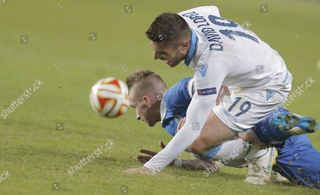 David Lopez (front) of Ssc Napoli in Action Against Alexander Buttner (back) of Dinamo Moscow During the Uefa Europa League Round of 16 Second Leg Soccer Match Between Dinamo Moscow and Ssc Napoli at Khimki Stadium in Moscow Russia 19 March 2015 Russian Federation Moscow