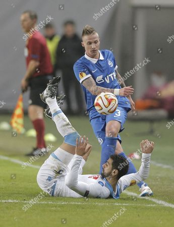 Miguel Britos (bottom) of Ssc Napoli in Action Against Alexander Buttner (top) of Dinamo Moscow During the Uefa Europa League Round of 16 Second Leg Soccer Match Between Dinamo Moscow and Ssc Napoli at Khimki Stadium in Moscow Russia 19 March 2015 Russian Federation Moscow