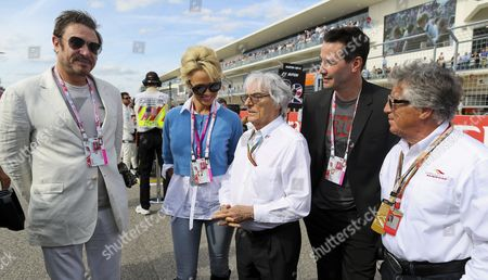Stock Photo of Formula 1 Boss Bernie Ecclestone (c) Posses with Us Actress Pamela Anderson (2nd L) English Musician Simon Lebon (l) Canadian Actor Keanu Reeves (2nd R) and Former Race Driver Mario Andretti (r) at the Grid Prior the United States Formula 1 Grand Prix at the Circuit of the Americas in Austin Texas Usa 02 November 2014 United States Austin