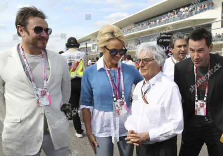 Formula 1 Boss Bernie Ecclestone (c) Posses with Us Actress Pamela Anderson (2nd L) English Musician Simon Lebon (l) and Canadian Actor Keanu Reeves (r) at the Grid Prior the United States Formula 1 Grand Prix at the Circuit of the Americas in Austin Texas Usa 02 November 2014 United States Austin
