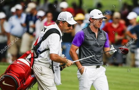 Rory Mcilroy of Northern Ireland (r) Hand His Driver to Caddie Jp Fitzgerald As They Walk Off the Fifth Tee During the Fourth Round of the 96th Pga Championship Golf Tournament at Valhalla Golf Club in Louisville Kentucky Usa 10 August 2014 United States Louisville