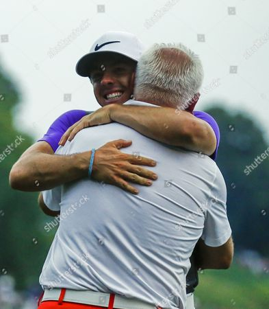 Rory Mcilroy of Northern Ireland (l) Embraces His Father Gerry Mcilroy After Winning the 96th Pga Championship Golf Tournament at Valhalla Golf Club in Louisville Kentucky Usa 10 August 2014 United States Louisville