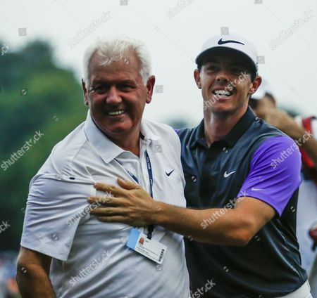 Rory Mcilroy of Northern Ireland (r) Embraces His Father Gerry Mcilroy After Winning the 96th Pga Championship Golf Tournament at Valhalla Golf Club in Louisville Kentucky Usa 10 August 2014 United States Louisville