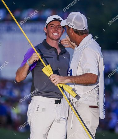 Rory Mcilroy of Northern Ireland (l) and Caddie Jp Fitzgerald (r) Celebrate After Mcilroy Won the 96th Pga Championship Golf Tournament at Valhalla Golf Club in Louisville Kentucky Usa 10 August 2014 United States Louisville