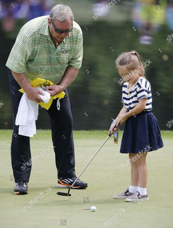 Fuzzy Zoeller of the Us Watches a Young Patron Putt For Him on the Ninth Hole During the Par 3 Contest at the 2015 Masters Tournament at the Augusta National Golf Club in Augusta Georgia Usa 08 April 2015 the Masters Tournament is Held 09 April Through 12 April 2015 United States Augusta