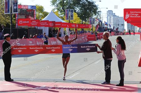 Rita Jeptoo (c) of Kenya Crosses the Finish Line to Win the 2014 Chicago Marathon in Chicago Illinois Usa 12 October 2014 This is the 37th Running of the Race That Attracts a Field of 45 000 Professional and Amateur Runners United States Chicago