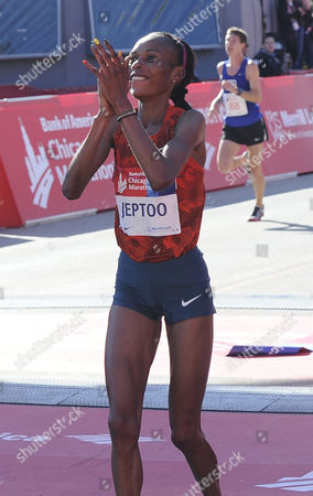 Rita Jeptoo of Kenya Celebrates After Winning the 2014 Chicago Marathon in Chicago Illinois Usa 12 October 2014 This is the 37th Running of the Race That Attracts a Field of 45 000 Professional and Amateur Runners United States Chicago