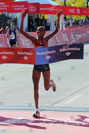 Stock Picture of Rita Jeptoo of Kenya Crosses the Finish Line to Win the 2014 Chicago Marathon in Chicago Illinois Usa 12 October 2014 This is the 37th Running of the Race That Attracts a Field of 45 000 Professional and Amateur Runners United States Chicago