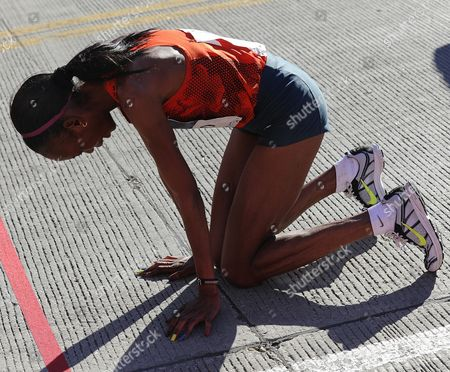 Rita Jeptoo of Kenya Rests After Winning the 2014 Chicago Marathon in Chicago Illinois Usa 12 October 2014 This is the 37th Running of the Race That Attracts a Field of 45 000 Professional and Amateur Runners United States Chicago