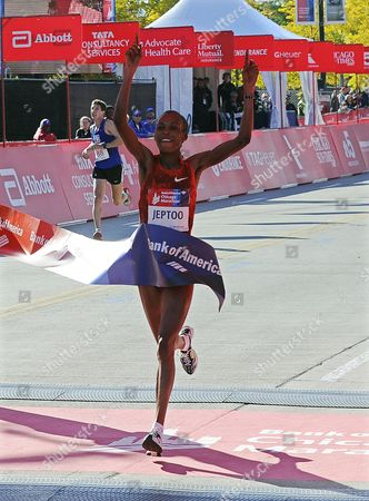 Rita Jeptoo of Kenya Crosses the Finish Line to Win the 2014 Chicago Marathon in Chicago Illinois Usa 12 October 2014 This is the 37th Running of the Race That Attracts a Field of 45 000 Professional and Amateur Runners United States Chicago