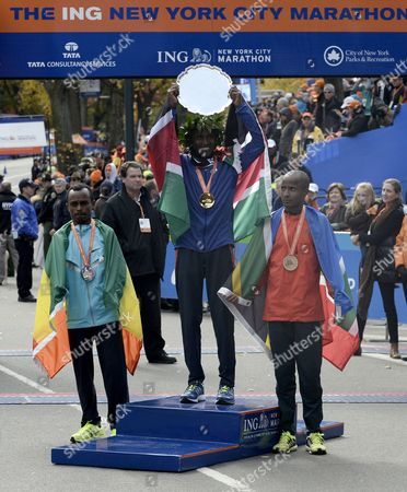 Winner Geoffrey Mutai of Kenya (c) Second Placed Tsegaye Kebede of Ethiopia (l) and Third Placed Lusapho April of South Africa (r) on the Podium After the New York City Marathon in New York New York Usa 03 November 2013 United States New York