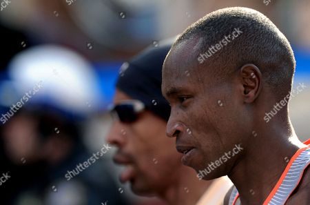 Geoffrey Mutai (r) of Kenya Competes in the New York City Marathon in New York New York Usa 03 November 2013 Mutai Defended His New York Marathon Title in 2 Hours 8 Minutes 24 Seconds United States New York