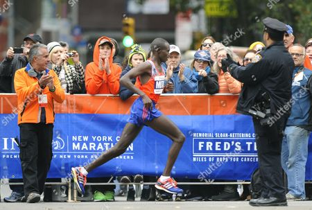 Geoffrey Mutai (c) of Kenya on His Way to Win the New York City Marathon in New York New York Usa 03 November 2013 Mutai Defended His New York Marathon Title in 2 Hours 8 Minutes 24 Seconds United States New York