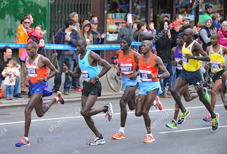 Geoffrey Mutai (l) of Kenya Competes in the New York City Marathon in New York New York Usa 03 November 2013 Mutai Defended His New York Marathon Title in 2 Hours 8 Minutes 24 Seconds United States New York