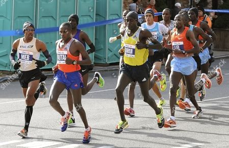 Meb Keflezighi (l) of the Us Looks Over to See Geoffrey Mutai (2-l) of Kenya During the New York City Marathon in New York New York Usa 03 November 2013 Mutai Defended His New York Marathon Title in 2 Hours 8 Minutes 24 Seconds United States New York