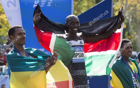 (l-r) Third Place Finisher Gebre Gebremariam of Ethiopia First Place Finisher Wilson Kipsang of Kenya and Second Place Finisher Lelisa Desisa of Ethiopia Hold Their Medals at the Finish Line of the 2014 New York City Marathon in New York New York Usa 02 November 2014 United States New York