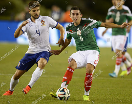 Mexico Midfielder Hector Herrera (r) Keeps the Ball From Portugal Midfielder Miguel Veloso(l) During the First Half Their International Friendly Match at Gillette Stadium in Foxborough Massachusetts Usa 06 June 2014 United States Foxborough