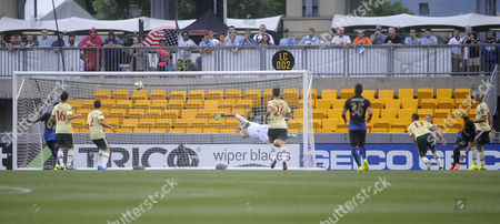 Manchester City's Scott Sinclair (2-r) Scroes a Goal Past Ac Milan Goalkeeper Michael Agazzi (c) During the International Champions Cup Match Between Ac Milan and Manchester City at Heinz Field in Pittsburgh Pennsylvania Usa 27 July 2014 United States Pittsburgh