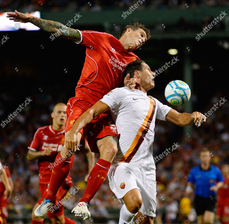 Liverpool's Daniel Agger (c) and As Roma's Marco Borriello (r) Battle For the Ball During the Second Half of As Roma's Win of Their Friendly Match Held at Fenway Park in Boston Massachusetts Usa 23 July 2014 United States Boston
