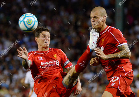 Liverpool's Daniel Agger (l) Kicks Teammate Martin Skrtel (r) During the Second Half of As Roma's Win Over Liverpool in Their Friendly Match Held at Fenway Park in Boston Massachusetts Usa 23 July 2014 United States Boston