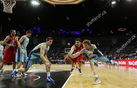 C J Wallace (r) of Fc Barcelona Regal and Vladimir Micov (2nd R) of Cska Moscow Challenge For Ball During Their Euroleague Basketball Final Four Third Place Match Fc Barcelona Regal Against Cska Moscow at O2 Arena in London Britain 12 May 2013 United Kingdom London