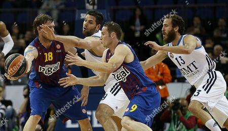 Felipe Reyes (2nd L) and Sergio Rodriguez (r) of Real Madrid Vies For Ball with C J Wallace (l) and Marcelinho Huertas (2nd R) of Fc Barcelona Regal During Their Euroleague Basketball Final Four Semi Final Match Fc Barcelona Regal Against Real Madrid at O2 Arena in London Britain 10 May 2013 United Kingdom London