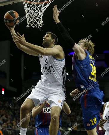 Felipe Reyes (l) of Real Madrid Goes to Basket Over Block of C J Wallace (r) of Fc Barcelona Regal During Their Euroleague Basketball Final Four Semi Final Match Fc Barcelona Regal Against Real Madrid at O2 Arena in London Britain 10 May 2013 United Kingdom London