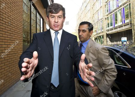 Godolphin Trainer Mahmood Al Zarooni (r) Arrives with a Minder (l) to a Disciplinary Panel of the British Horseracing Authority in London Britain 25 April 2013 Al Zarooni was Charged by the British Horseracing Authority After Samples From 11 of His Horses Were Found to Have Contained Traces of Anabolic Steroids United Kingdom London