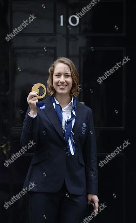 Britain's Women's Skeleton Sochi Olympic 2014 Winter Games Gold Medal Winner Elizabeth Yarnold Outside the London Residence of the British Prime Minister David Cameron Number 10 Downing Street in Central London England 25 February 2014 the Olympic 2014 Winter Games Competitors Arrived For a Meeting with David Cameron United Kingdom London