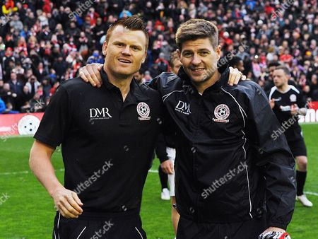 Steven Gerrard (r) Poses with John Arne Riise (l) After the Liverpool All-star Charity Soccer Match at Anfield in Liverpool Britain 29 March 2015 United Kingdom Liverpool