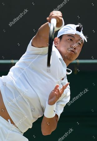 Jimmy Wang of Taiwan Serves to Jo-wilfried Tsonga of France in Their Third Round Match During the Wimbledon Championships at the All England Lawn Tennis Club in London Britain 27 June 2014 United Kingdom Wimbledon