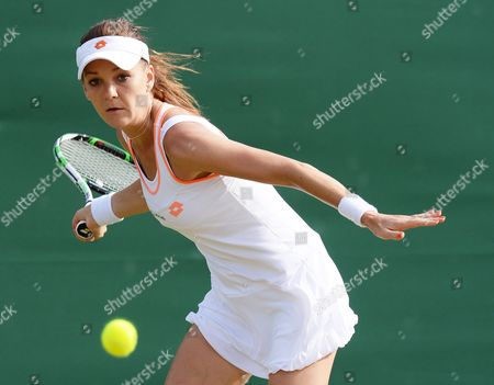 Agnieszka Radwanska of Poland Returns to Michelle Larcher De Brito of Portugal in Their Third Round Match During the Wimbledon Championships at the All England Lawn Tennis Club in London Britain 27 June 2014 United Kingdom Wimbledon
