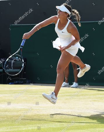 Michelle Larcher De Brito of Portugal Serves to Agnieszka Radwanska of Poland in Their Third Round Match During the Wimbledon Championships at the All England Lawn Tennis Club in London Britain 27 June 2014 United Kingdom Wimbledon