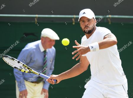Jo-wilfried Tsonga of France Returns to Jimmy Wang of Taiwan in Their Third Round Match During the Wimbledon Championships at the All England Lawn Tennis Club in London Britain 27 June 2014 Epa/andy Rain United Kingdom Wimbledon