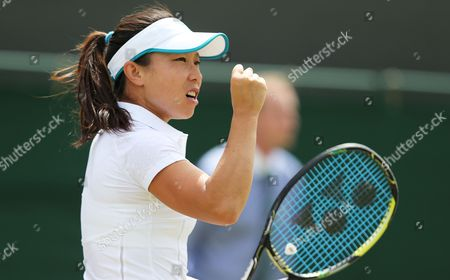 Jie Zheng of China Celebrates a Point Against Ana Ivanovic of Serbia During Their Second Round Match at the Wimbledon Championships at the All England Lawn Tennis Club in London Britain 26 June 2014 United Kingdom Wimbledon