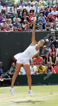 Ana Ivanovic of Serbia in Action Against Jie Zheng of China During Their Second Round Match of the Wimbledon Championships at the All England Lawn Tennis Club in London Britain 26 June 2014 United Kingdom Wimbledon