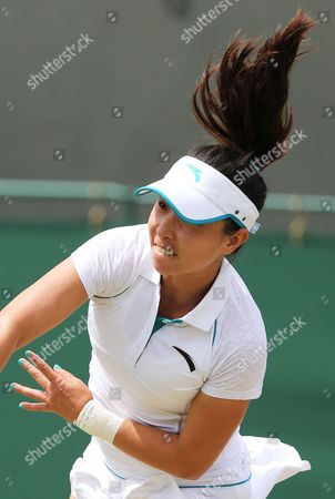 Jie Zheng of China Returns to Ana Ivanovic of Serbia During Their Second Round Match at the Wimbledon Championships at the All England Lawn Tennis Club in London Britain 26 June 2014 United Kingdom Wimbledon