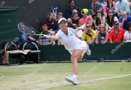 Stock Photo of Jie Zheng of China Returns to Ana Ivanovic of Serbia During Their Second Round Match at the Wimbledon Championships at the All England Lawn Tennis Club in London Britain 26 June 2014 United Kingdom Wimbledon