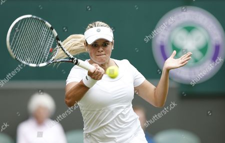 Aleksandra Wozniak of Canada Returns to Dominika Cibulkova of Slovakia in Their First Round Match During the Wimbledon Championships at the All England Lawn Tennis Club in London Britain 23 June 2014 United Kingdom Wimbledon