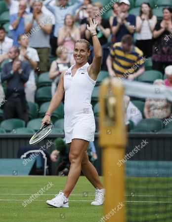Dominika Cibulkova of Slovakia Celebrates Her Win Over Aleksandra Wozniak of Canada in Their First Round Match During the Wimbledon Championships at the All England Lawn Tennis Club in London Britain 23 June 2014 United Kingdom Wimbledon