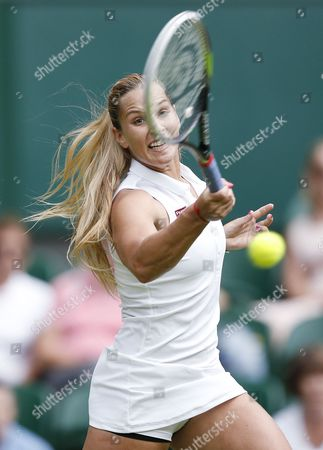 Dominika Cibulkova of Slovakia Returns to Aleksandra Wozniak of Canada in Their First Round Match During the Wimbledon Championships at the All England Lawn Tennis Club in London Britain 23 June 2014 United Kingdom Wimbledon