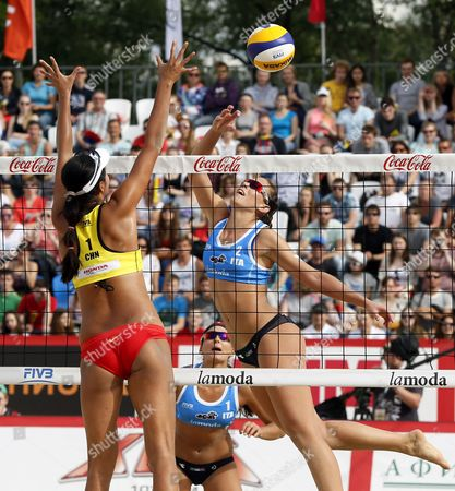 Marta Menegatti (bottom) and Viktoria Orsi Toth (r) of Italy in Action Against Fan Wang of China During Women's Bronze Medal Match at the Beach Volley Grand Slam of the Swatch Fivb World Tour in Moscow Russia 31 May 2015 Russian Federation Moscow