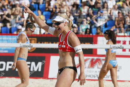 Marleen Van Lersel (c) of Netherlands in Action Against Marta Menegatti (l) and Viktoria Orsi Toth of Italy Women's Semifinal Beach Volley Grand Slam of the Swatch Fivb World Tour in Moscow Russia 30 May 2015 Russian Federation Moscow