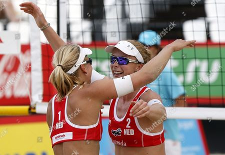 Marleen Van Lersel (l) and Madelein Meppelink (r) of Netherlands Celabrate Their Victory Over Marta Menegatti and Viktoria Orsi Toth of Italy During Women's Semifinal of Beach Volley Grand Slam of the Swatch Fivb World Tour in Moscow Russia 30 May 2015 Russian Federation Moscow
