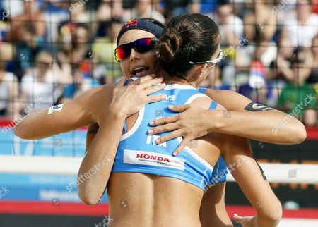 Marta Menegatti (l) and Viktoria Orsi Toth of Italy React During Women's Bronze Medal Match at the Beach Volley Grand Slam of the Swatch Fivb World Tour Against Fan Wang and Yuan Yue of China in Moscow Russia 31 May 2015 Russian Federation Moscow