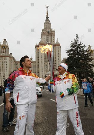 Stock Picture of Professional Boxer Kostya Tszyu (r) and Russian Singer Dima Bilan Hold Their Torches During the Relay Race in Moscow Russia 07 October 2012 Russia Welcomed the Olympic Flame on 06 October For the Start of an Epic Torch Relay Across the Country Leading to the Opening Ceremony of the Winter Games in Sochi on February 7 Russian Federation Moscow